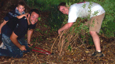 Josh, Silas, and I, hacking up some bushes.