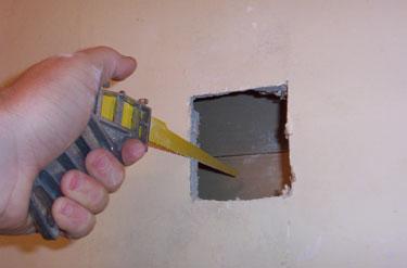 1-Cut away damaged drywall.