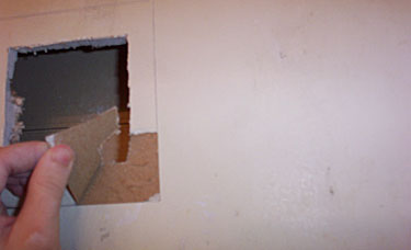 6-Removing paper from wall.